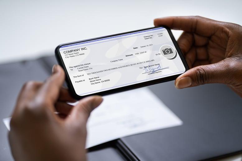 mobile banking user depositing check using mobile phone