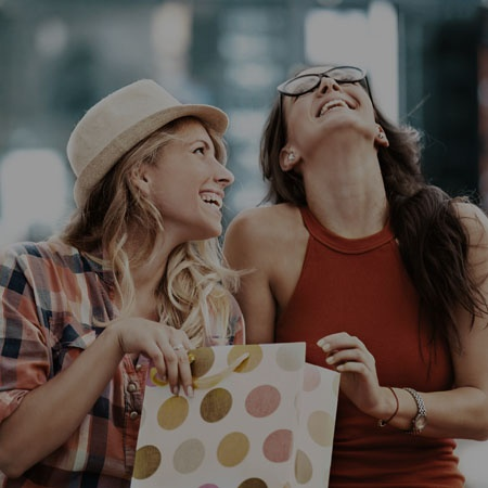 girls laughing while shopping