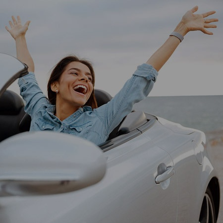 young woman in convertible car