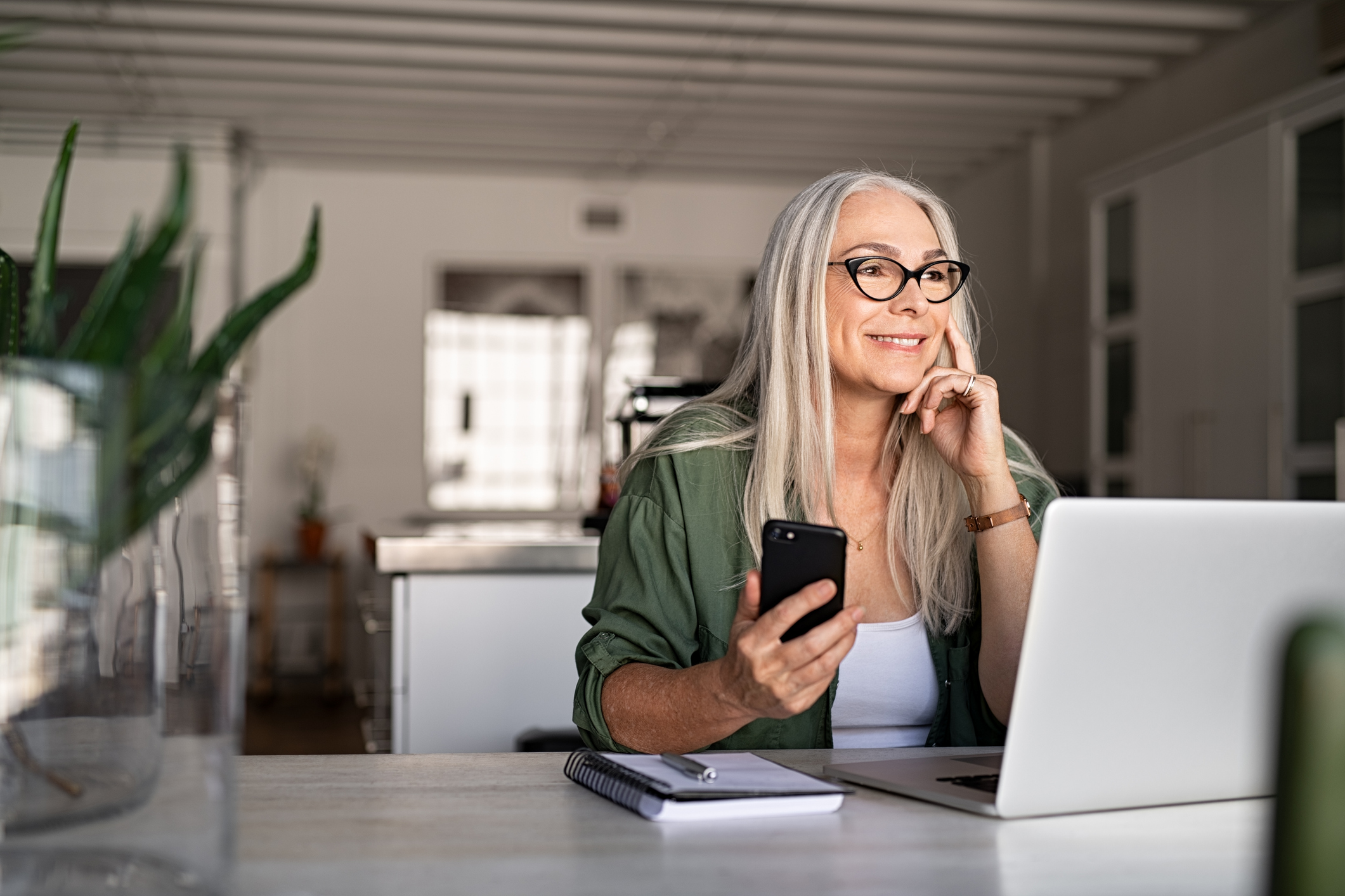 Woman setting up automatic bill pay on her mobile banking app