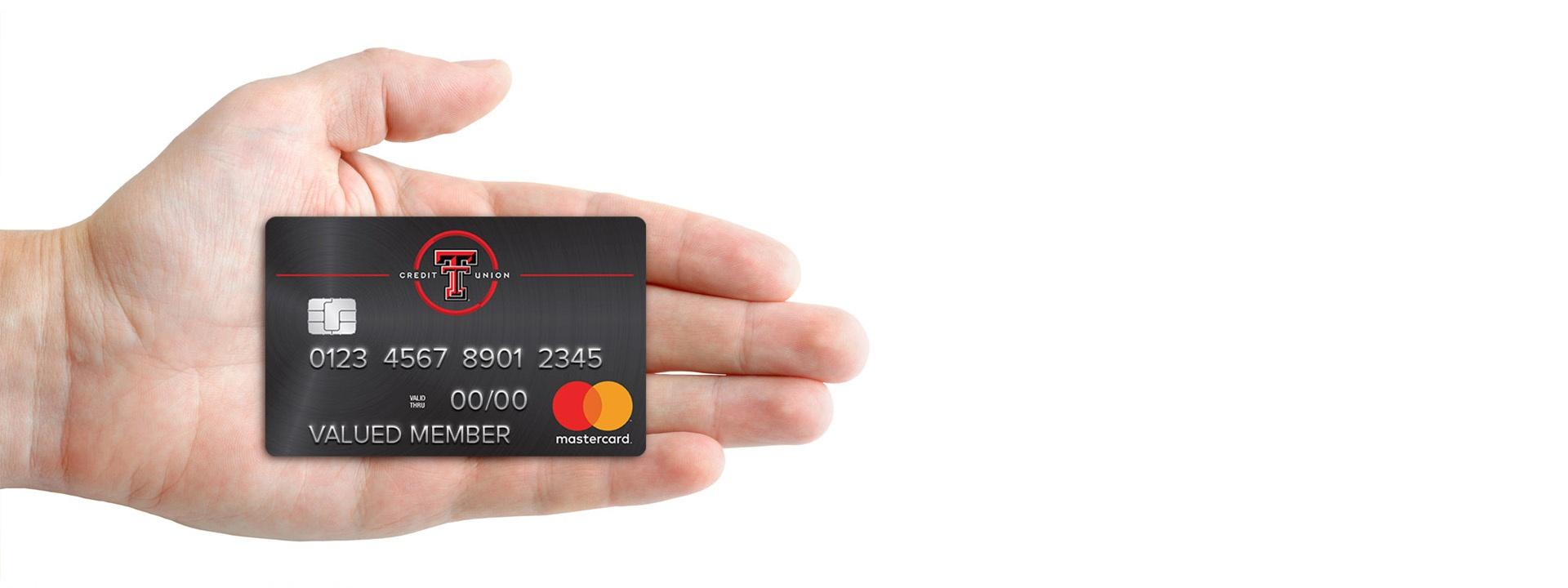 hand holding texas tech credit union black card